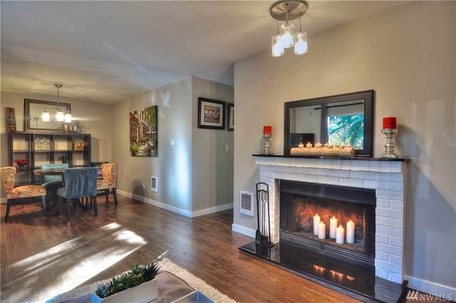 14018 NE 181st Place E-202, Woodinville, WA 98072 (#1535558) :: Alchemy Real Estate