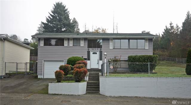 9256 11th Ave SW, Seattle, WA 98106 (#1537408) :: Better Homes and Gardens Real Estate McKenzie Group