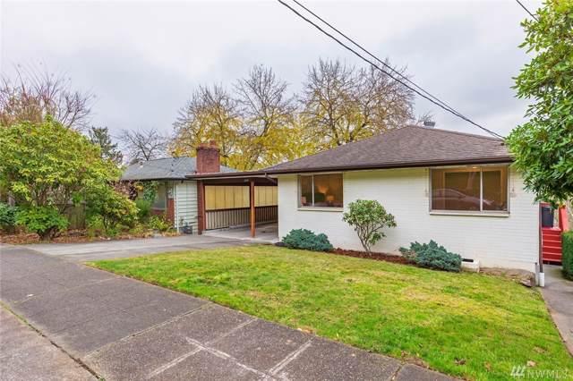 2828 23rd Ave W, Seattle, WA 98199 (#1544383) :: Liv Real Estate Group