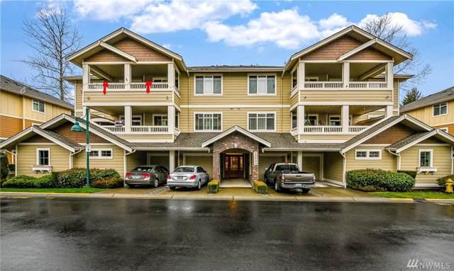 23924 NE 115th Lane #202, Redmond, WA 98053 (#1548017) :: Chris Cross Real Estate Group