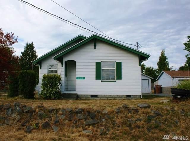 1319 E 56th St, Tacoma, WA 98404 (#1548642) :: Canterwood Real Estate Team