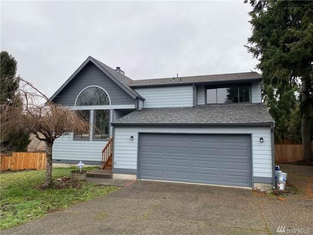 11944 SE 212th Place, Kent, WA 98031 (#1551022) :: KW North Seattle