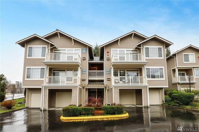 18626 NE 57th Wy #18626, Redmond, WA 98052 (#1562365) :: Keller Williams Western Realty