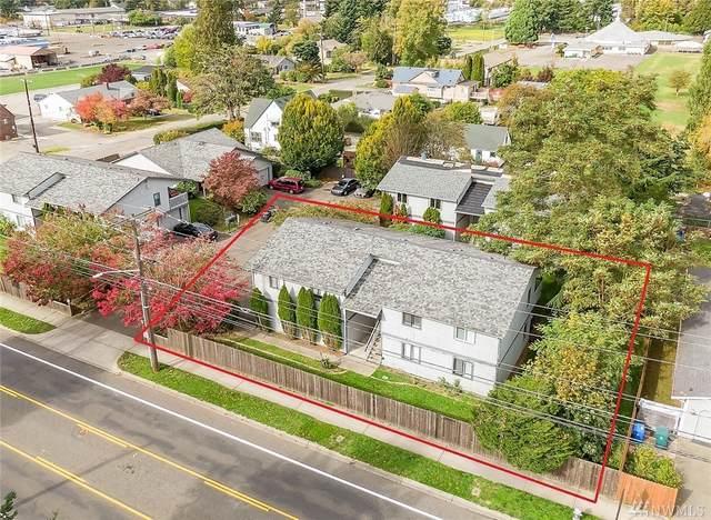 115 E 96th St, Tacoma, WA 98445 (#1564621) :: The Kendra Todd Group at Keller Williams
