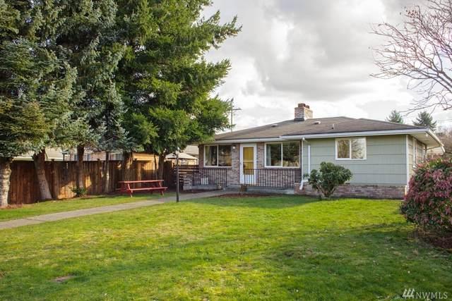 242 E 60th St, Tacoma, WA 98404 (#1565987) :: The Kendra Todd Group at Keller Williams