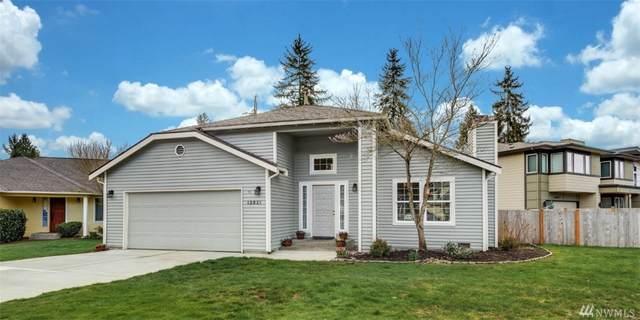12821 NE 101st Place, Kirkland, WA 98033 (#1566875) :: Mary Van Real Estate