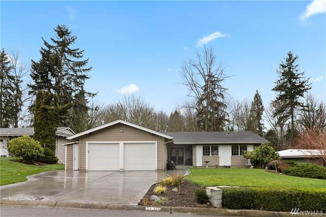14310 NE 77th St, Redmond, WA 98052 (#1570251) :: Hauer Home Team