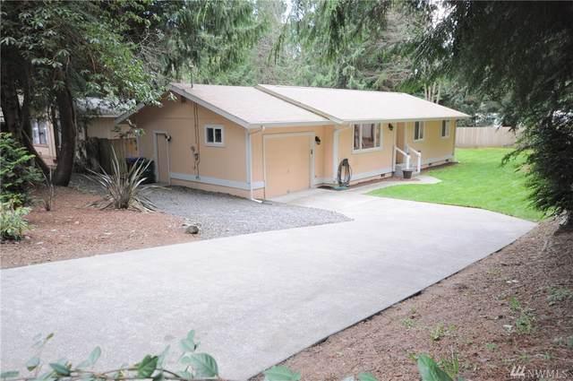 8245 NE Beachwood Ave, Poulsbo, WA 98370 (#1576366) :: Better Homes and Gardens Real Estate McKenzie Group