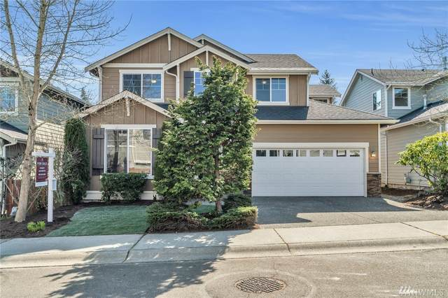 12923 NE 204th Place, Woodinville, WA 98072 (#1581607) :: Keller Williams Realty