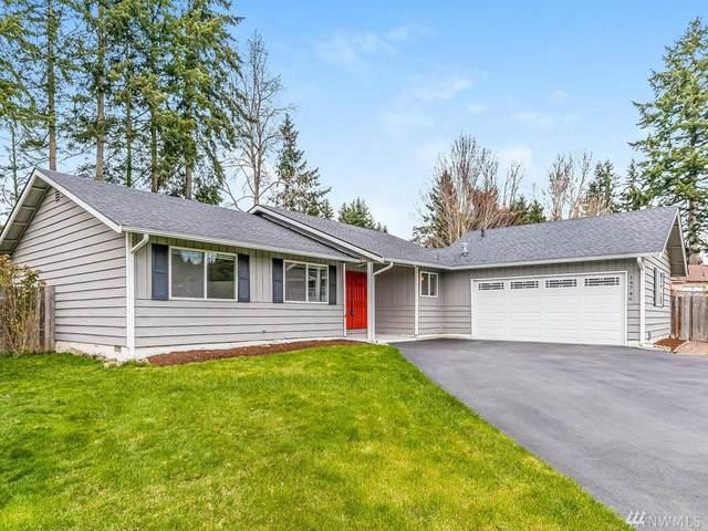 14746 112th Ave NE, Kirkland, WA 98034 (#1585536) :: Mary Van Real Estate