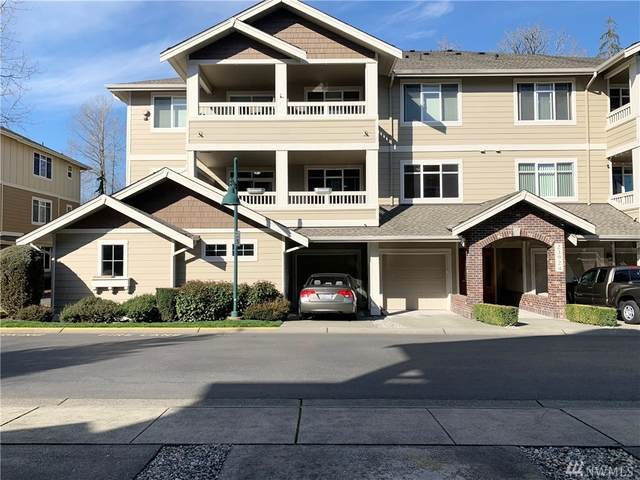 23924 NE 115th Lane #204, Redmond, WA 98053 (#1585930) :: Keller Williams Western Realty