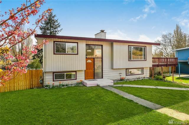 11212 18th Ave SW, Seattle, WA 98146 (#1592065) :: Hauer Home Team