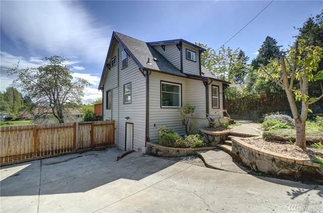 9744 49th Ave S, Seattle, WA 98118 (#1594090) :: Hauer Home Team