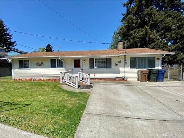 1101 E 48th St, Tacoma, WA 98404 (#1597776) :: Hauer Home Team