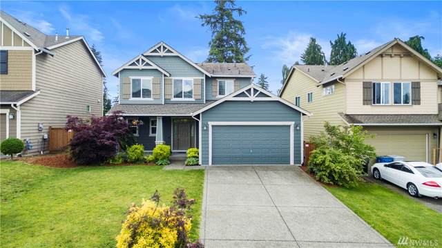 9501 S 235th Place, Kent, WA 98031 (#1605233) :: Hauer Home Team