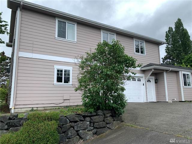 1715 S 48th St, Tacoma, WA 98408 (#1606479) :: Keller Williams Western Realty