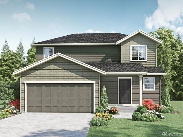 10836 185th St E #404, Puyallup, WA 98374 (#1607290) :: Hauer Home Team