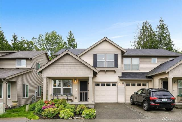 11220 241st Lane NE #107, Redmond, WA 98053 (#1609400) :: Capstone Ventures Inc
