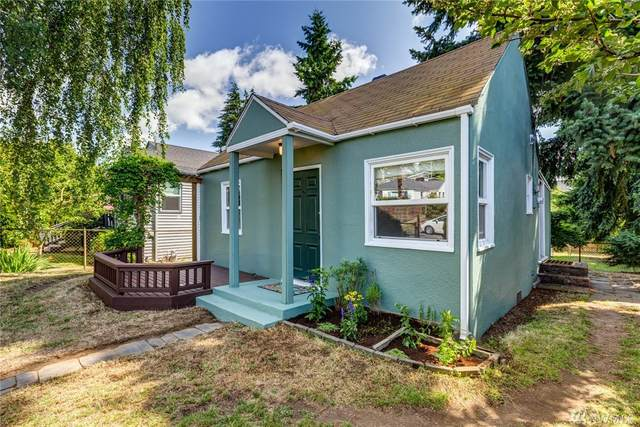 8738 18th Ave NW, Seattle, WA 98117 (#1615014) :: Canterwood Real Estate Team