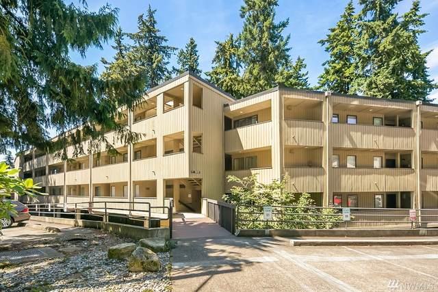 10819 NE 37th Place #102, Bellevue, WA 98004 (#1622038) :: Canterwood Real Estate Team