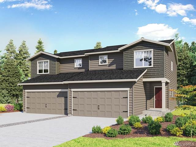 28312 64th Ct NW #106, Stanwood, WA 98292 (#1622430) :: Real Estate Solutions Group
