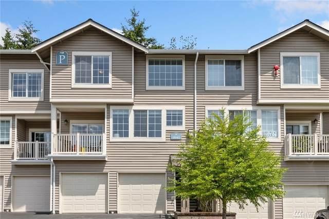 18642 NE 57th Wy #18642, Redmond, WA 98052 (#1624529) :: Canterwood Real Estate Team