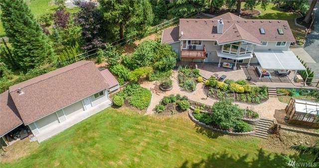 14815 NE 219th Ave, Woodinville, WA 98077 (#1625652) :: Pickett Street Properties