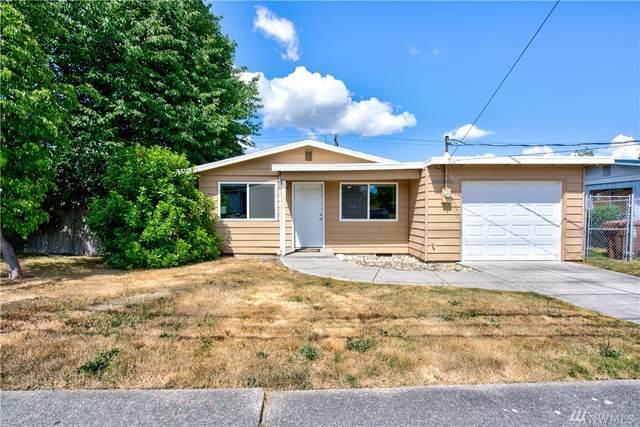 1407 E 64th St, Tacoma, WA 98404 (#1637654) :: Hauer Home Team