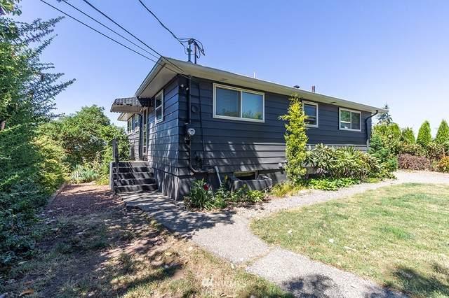9056 22nd Avenue SW, Seattle, WA 98106 (#1644265) :: Keller Williams Western Realty