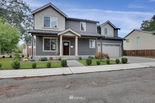 4717 S 71st St, Tacoma, WA 98409 (#1648213) :: Hauer Home Team