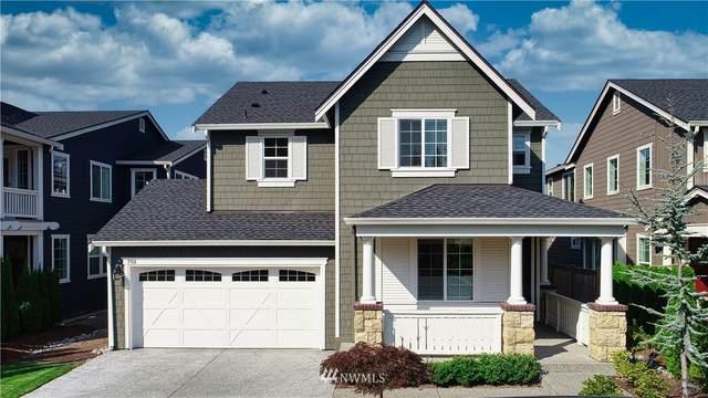 7713 127th Place NE, Kirkland, WA 98033 (#1660778) :: NextHome South Sound