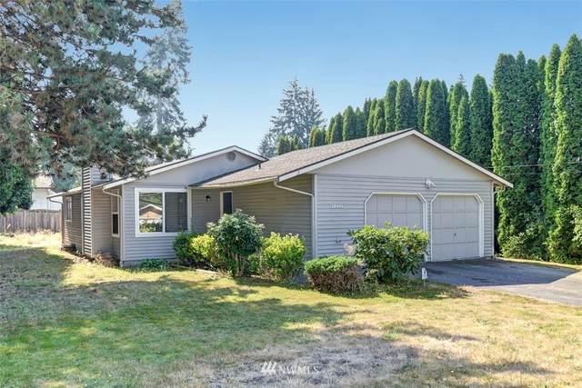 12411 NE 107th Place, Kirkland, WA 98033 (#1661192) :: NextHome South Sound