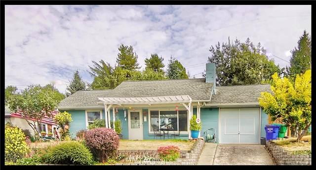 9208 24th Avenue SW, Seattle, WA 98106 (#1667942) :: Keller Williams Western Realty