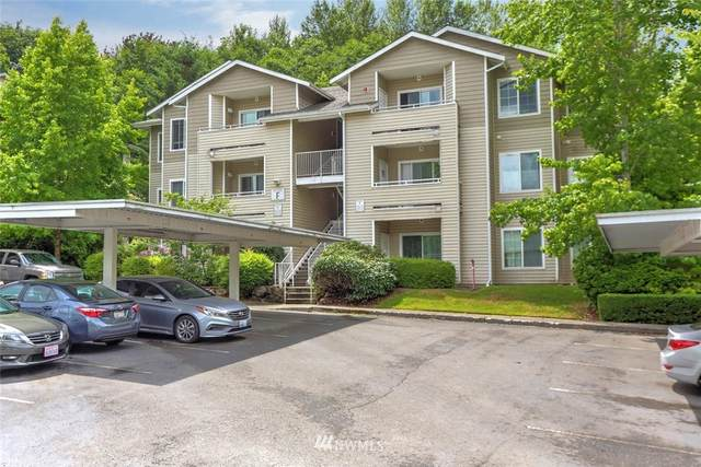 801 Rainier Avenue N F230, Renton, WA 98057 (#1673976) :: The Robinett Group