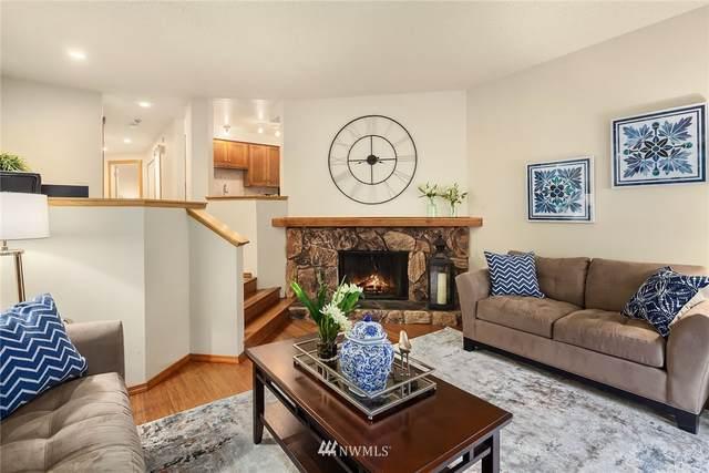 12034 96th Avenue NE #214, Kirkland, WA 98034 (#1680259) :: Keller Williams Realty