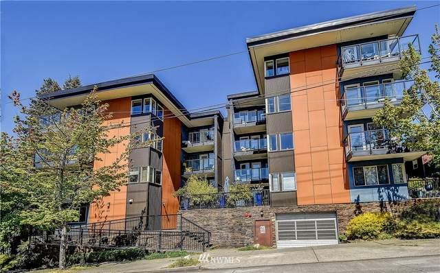 120 NW 39th Street #205, Seattle, WA 98107 (#1680774) :: Pickett Street Properties