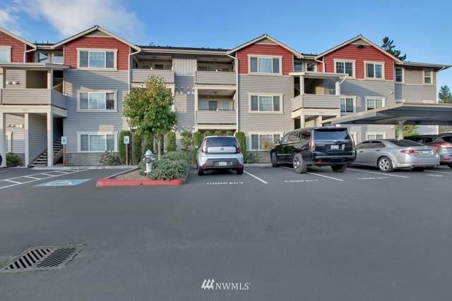 13203 97th Avenue E #302, Puyallup, WA 98373 (#1680995) :: Ben Kinney Real Estate Team