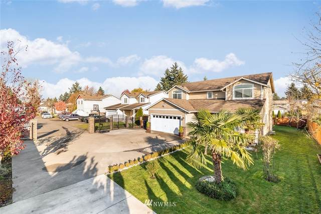 218 E 68th Street, Tacoma, WA 98404 (#1691710) :: Ben Kinney Real Estate Team