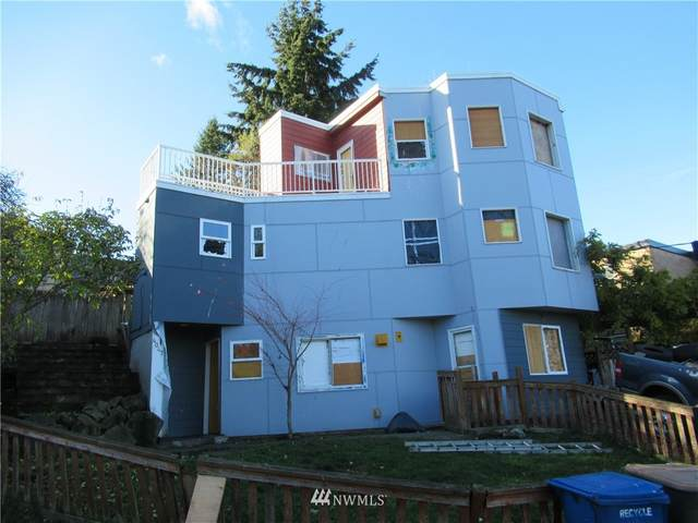 4047 25th Avenue W, Seattle, WA 98199 (#1693568) :: TRI STAR Team | RE/MAX NW