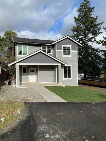 1121 E 57th Street, Tacoma, WA 98404 (#1697524) :: Pickett Street Properties