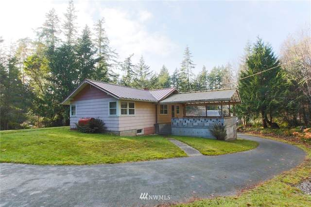 6500 NE Hidden Cove Road, Bainbridge Island, WA 98110 (#1698285) :: Pickett Street Properties
