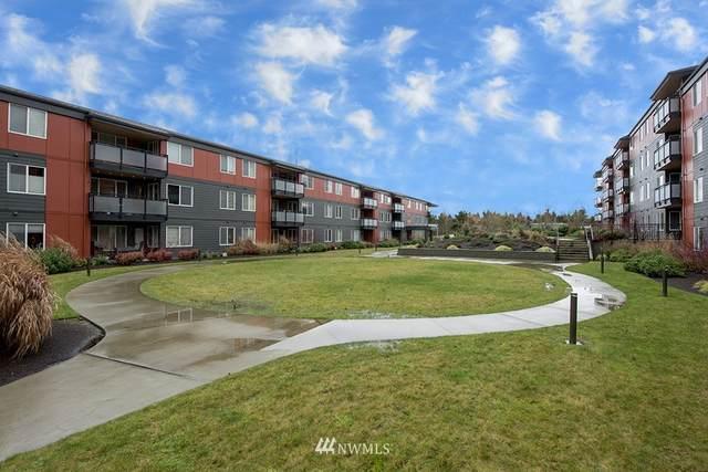 7021 Sand Point Way NE B402, Seattle, WA 98115 (#1713697) :: Hauer Home Team