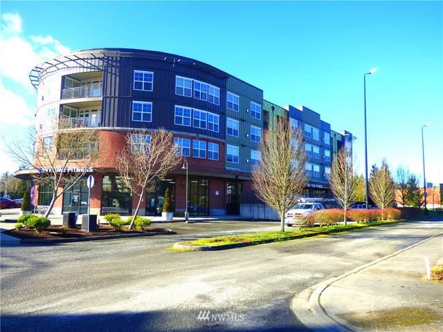 7104 265th Street NW #207, Stanwood, WA 98292 (#1723450) :: Shook Home Group