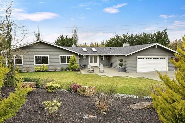 8411 NE 21st Place, Clyde Hill, WA 98004 (#1729111) :: Alchemy Real Estate