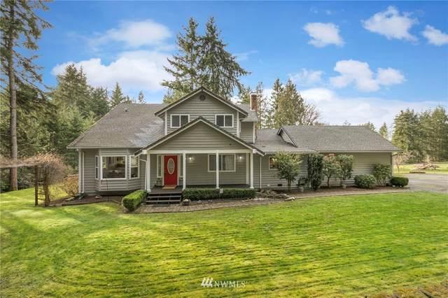 24301 Rhododendron Lane NW, Poulsbo, WA 98370 (MLS #1733051) :: Brantley Christianson Real Estate
