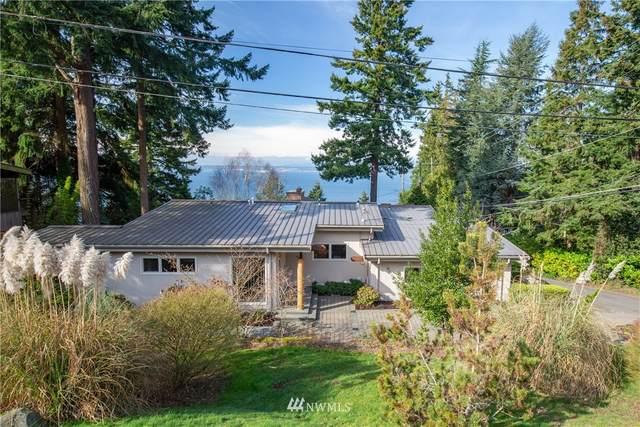 4007 57th Avenue SW, Seattle, WA 98116 (#1738891) :: Keller Williams Realty