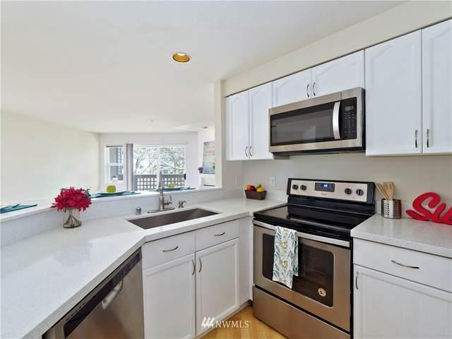 15917 Waynita Way NE E-104, Bothell, WA 98011 (#1748062) :: McAuley Homes