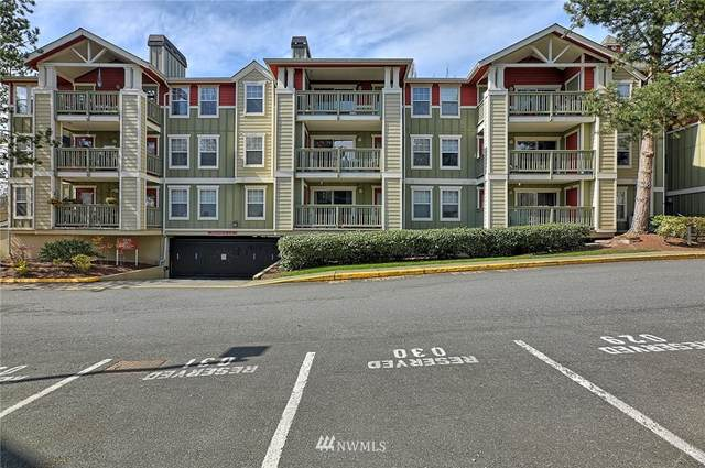 7711 NE 175th Street A205, Kenmore, WA 98028 (#1749097) :: Urban Seattle Broker