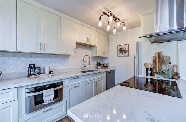 11556 N Greenwood Avenue #203, Seattle, WA 98133 (#1762437) :: Lucas Pinto Real Estate Group