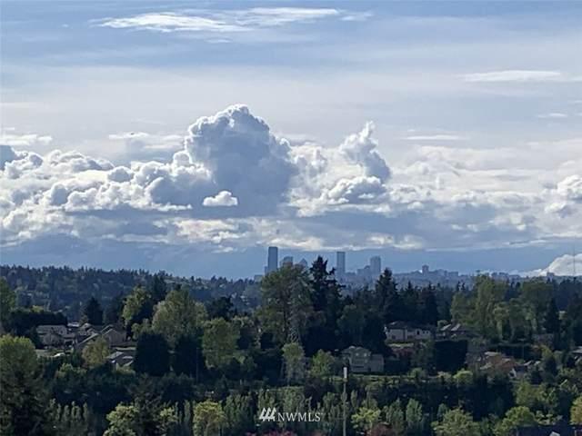 3821 131st Lane SE G7, Bellevue, WA 98006 (#1765118) :: TRI STAR Team | RE/MAX NW